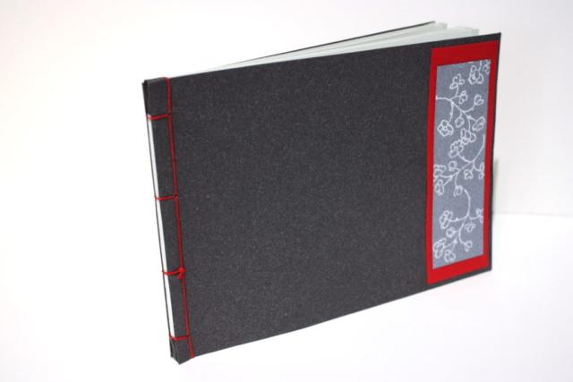 Japanse binding, Japans boekje, leren kapjes, handgemaakt, boekbinden, stempel