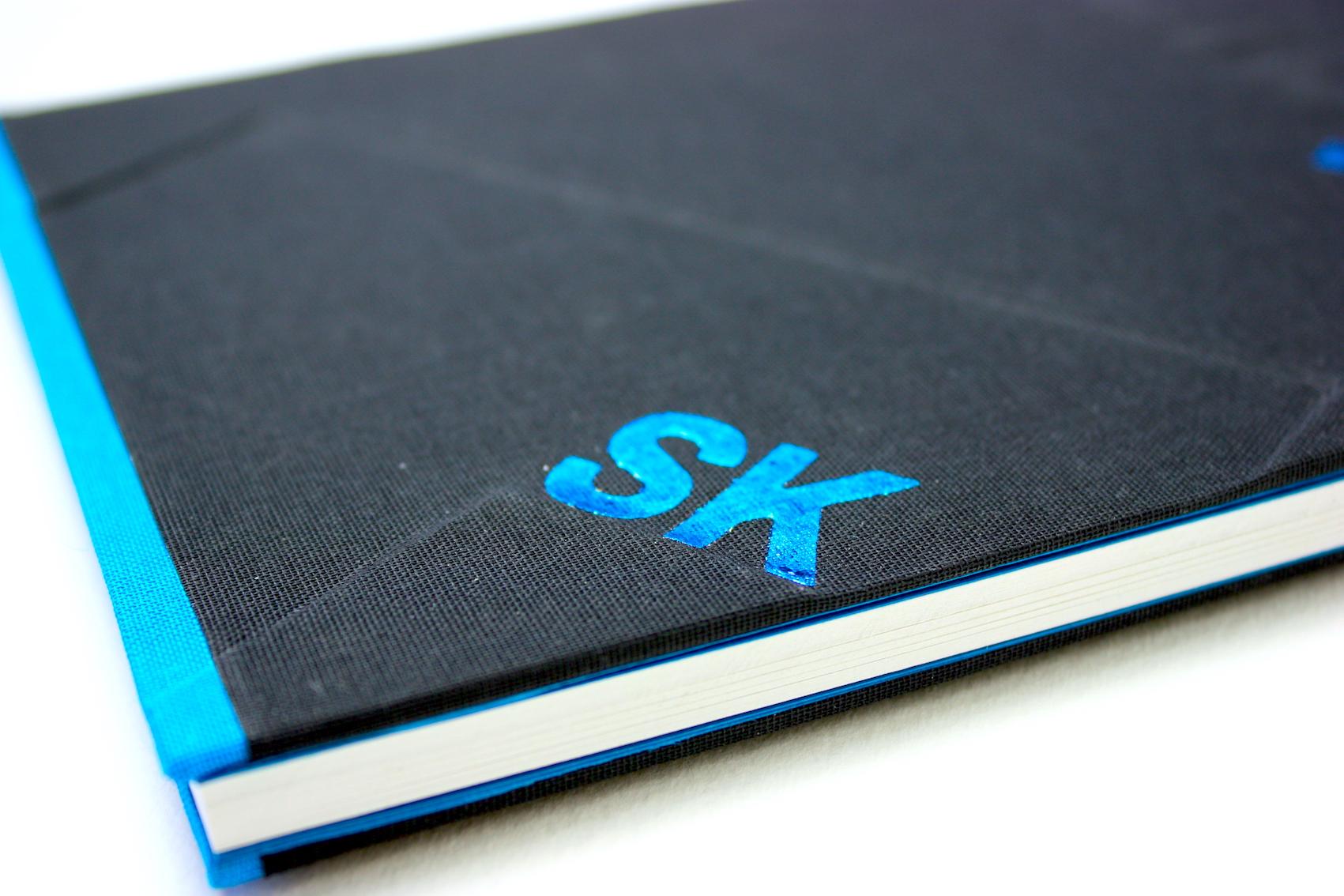 Notitieboeken bedrijfslogo geheel linnen preeg elastiek foliedruk