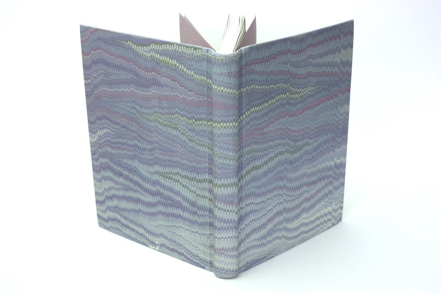 Boek bradel binding papieren omslag hand gemaakt marmerpapier